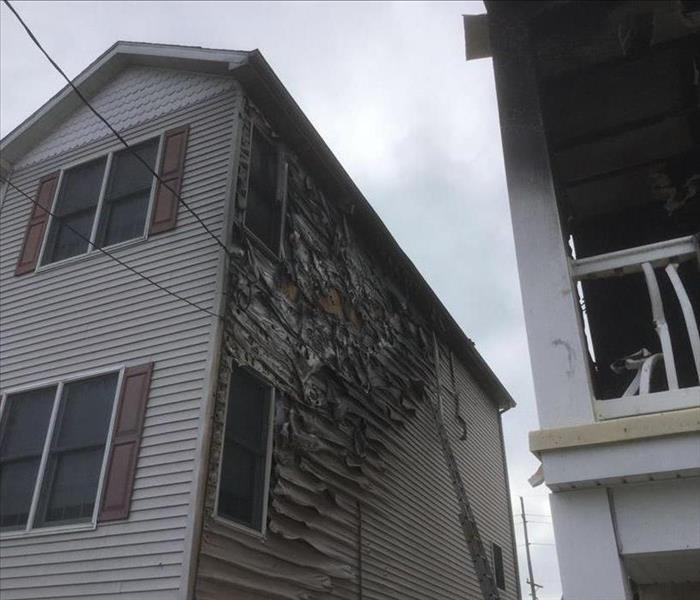 Neighboring Fire Leaves Home Damaged Before