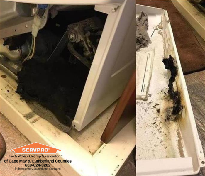 Photo of dryer with back panel pulled off to show dirty dryer vent.