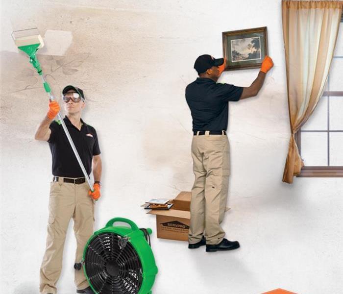 SERVPRO technicians inside a home cleaning and deodoraizing