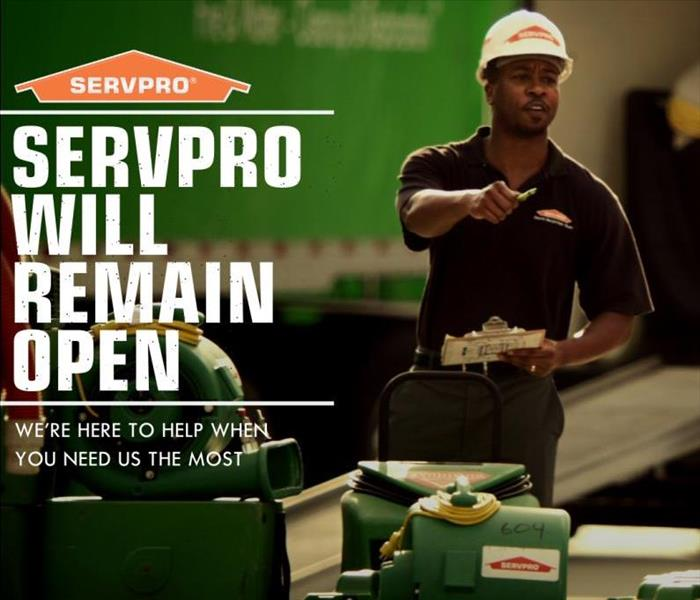 "Photo of SERVPRO Professional with the words ""SERVPRO will remain open."""
